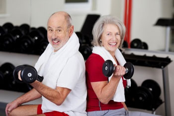 Elderly Couple Lifting Weights